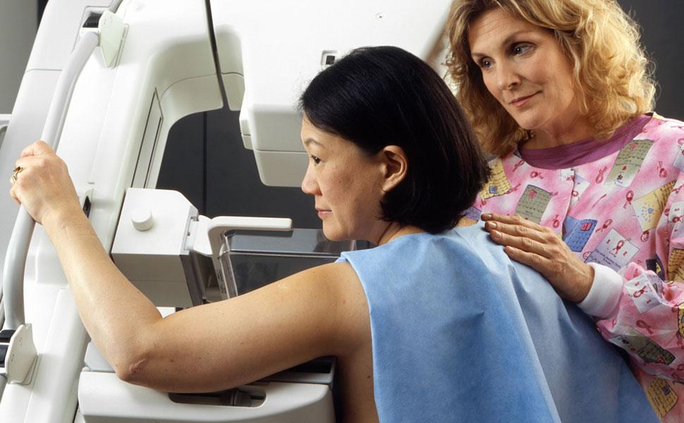 Woman having mammogram test