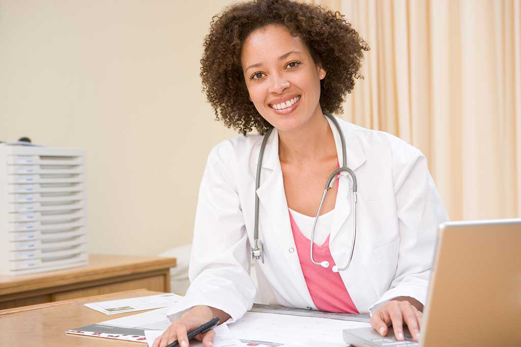 Female general practitioner smiling in doctors clinic