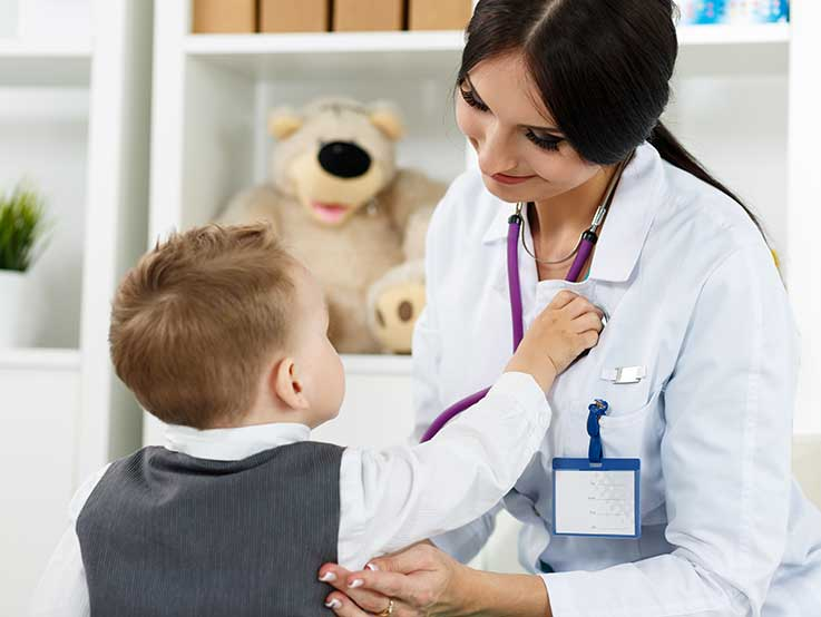 Family doctor - paediatric consultant available at Epping. Little child visiting paediatrician playing with stethoscope.